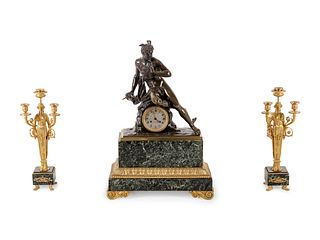 An Empire Style Gilt and Patinated Bronze and Marble Clock Garniture