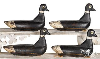Rig of four carved and painted duck decoys