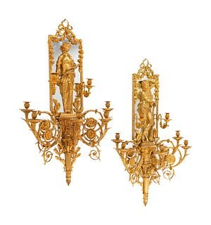 A Pair of Large Louis XVI Style Mirrored Gilt Bronze Figural Sconces
