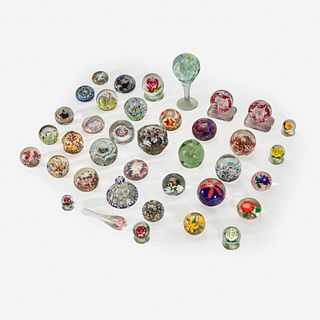 A collection of assorted glass paperweights Millville, New Jersey, Cambridge, Ohio, Sandwich, Massachusetts,  England and France 19th and 20th century