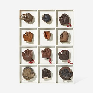 A collection of twelve miniature leather baseball gloves first half 20th century