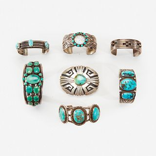 A group of Navajo silver and turquoise bracelet/cuffs and a belt buckle 20th century