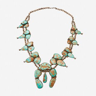 A Navajo silver and Royston turquoise squash blossom necklace 20th century