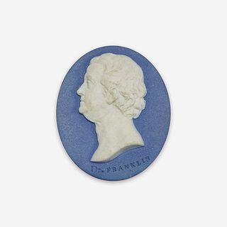 A Wedgwood & Bentley blue and white Jaspwerware portrait medallion of Benjamin Franklin (1706-1790) Designed by William Hackwood, Etruria, Staffordshi