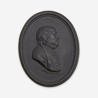A Wedgwood black basalt portrait medallion of Benjamin Franklin (1706-1790) Etruria, Staffordshire, after 1780