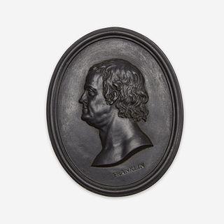 A Wedgwood & Bentley black basalt portrait medallion of Benjamin Franklin (1706-1790) Modeling attributed to William Hackwood, Etruria, Staffordshire,