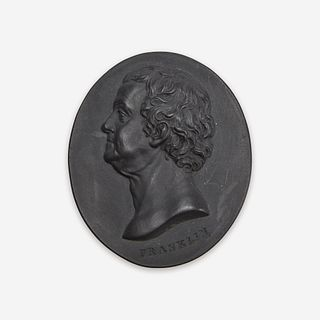 A Wedgwood & Bentley black basalt portrait medallion of Benjamin Franklin (1706-1790) Designed by William Hackwood, Etruria, Staffordshire, circa 1780