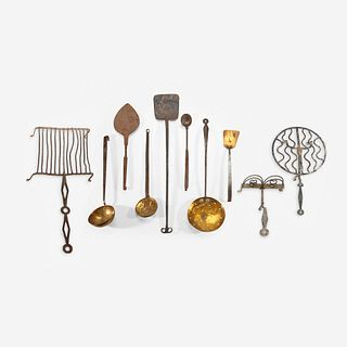 A group of ten wrought iron and brass fireplace cooking items 18th/19th century