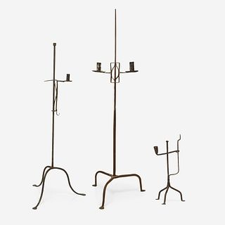 A group of three wrought iron candle stands 18th/19th century