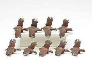 Nine miniature flying bobwhite quail, Aubrey J. Dando, Philadelphia, Pennsylvania.