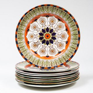 Set of Nine Royal Doulton Transfer Printed and Enriched Dinner Plates