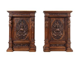 A Pair of Renaissance Revival Carved Walnut Marble Top Cabinets