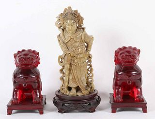 Pair of Chinese Carved Red Amber Fu Dogs