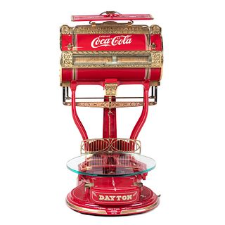 A Red Dayton Computing Scale with Coca-Cola Advertisement