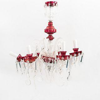 """Candil. Siglo XX. Elaborado en cristal transparente y color rojo. Para 6 luces. Con arandelas circulares, brazos en """"S"""""""