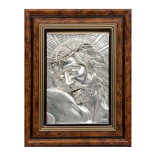 Divino rostro. Italia. Siglo XX. Elaborado en resina moldeada con electrobaño plateado. Enmarcado. 41 x 31 cm