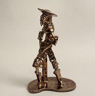 Don Quijote. Siglo XX. Elaborado en cerámica esmaltada tipoNischli. Acabado metálico. Con base. 37.5 cm altura