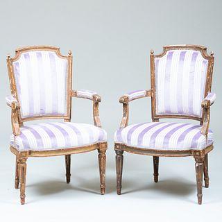 Pair of Louis XVI Style Painted and Parcel-Gilt Fauteuils en Cabriolet