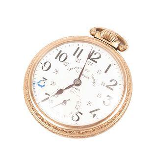 Reloj de bolsillo serv. del tiempo. Mecanismo de cuerda, caja de metal dorado con subesfera.