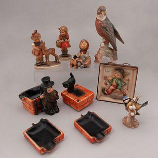 Lote de 7 piezas. Alemania. Siglo XX. Elaborados en porcelana Goebel y Hummel. Acabados gres y brillante.