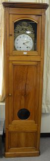 French Fruitwood Tall Clock having brass works, porcelain dial, with pendulum and weights, height 83 inches, width 22 1/2 inches, depth 15 inches.