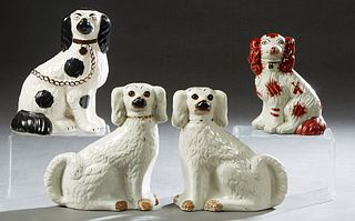 Group of Four English Staffordshire Dogs, 19th c., consisting of a pair of white examples; a single black and white example, and a small brown and whi