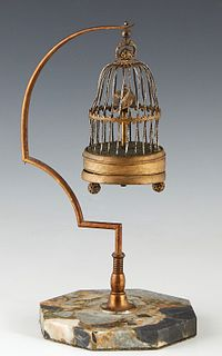 Miniature Brass Bird Cage Annular Clock, early 20th c., on a brass support to an octagonal highly figured marble stand, not running, H.- 11 1/4 in., W