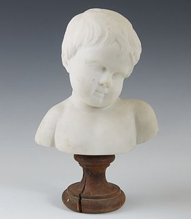 Continental Carved Marble Bust of a Child, late 19th c., on a wooden socle base, H.- 10 5/8 in., W.- 6 1/2 in., D.- 4 1/4 in.
