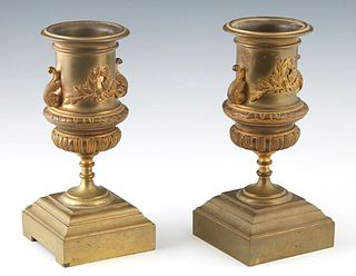 Pair of Gilt Bronze Garniture Urns, 19th c., with an everted rim over relief decoration of a laurel wreath, on a socle support, to a stepped square ba