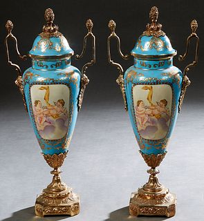Pair of Sevres Style Brass Ormolu Mounted Porcelain Covered Urns, 20th/21st c., of tapered form, in heavennly blue with gilt and enamel decoration, ar
