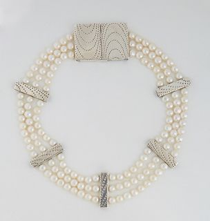 Mignon Faget Sterling Silver Necklace, with three strands of 7mm pearls and five indented rectangular spacers, with a large indented decorated sterlin