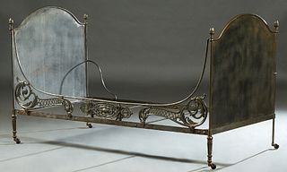 Contemporary Iron Campaign Style Daybed, 20th c., the arched solid head and footboards joined by a pierced floral and scroll front rail and a plain ba