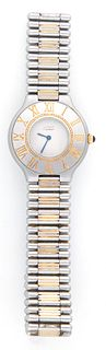 Lady's Must de Cartier 21 Stainless Gold Plated Steel Quartz Wristwatch, c. 1990, Model 1340, Ser. # 001029132, with a sapphire mounted bezel.