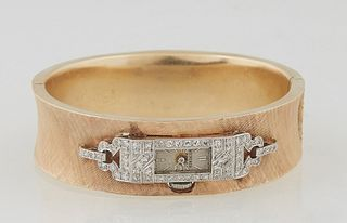 Bucherer Art Deco Manual Wind 18K Yellow Gold Bangle Watch, with an elaborate diamond mounted bezel and lugs, the curved bracelet with a Florentine fi