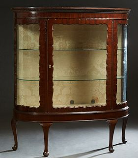 Large Edwardian Queen Anne Style Curved Glass Curio Cabinet, c. 1910, the stepped gadrooned crown over a scalloped curved glass door, flanked by scall