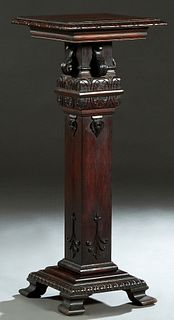 American Carved Mahogany Pedestal, late 19th c., the carved rounded edge square top on a stepped square support with applied leaf and scroll carving,