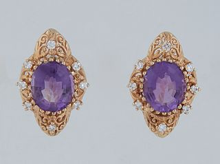 Pair of 18K Yellow Gold Pierced Earrings, each with an oval 4.5 ct. amethyst within a shaped pierced border mounted with eight five point round diamon