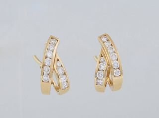 Pair of 18K Yellow Gold Pierced Earrings, with looped crossed bands , each earring with ten bezel set round ten point diamonds, with Omega clasps, tot