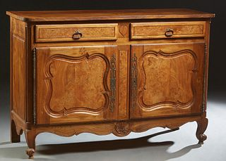 French Provincial Carved Elm Louis XV Style Sideboard, early 20th c., the rounded corner top over two frieze drawers flanking a relief carved heart, a