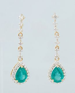 Pair of 18K Yellow Gold Pendant Earrings, with a diamond mounted stud to a five link diamond mounted chain suspending a .94 ct. pear shaped emerald at