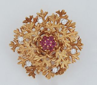 Vintage 18k Yellow Gold Circular Leaf Brooch, the center mounted with seven round seven point rubies, the outer border of the pin with six ten point r