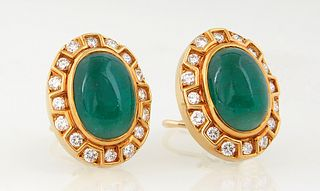 Pair of 18K Yellow Gold Pierced Earrings, with an oval cabochon 12mm x 18mm jade stone atop a conforming border of three sided open boxes, with 15 rou