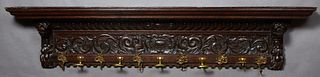 French Carved Oak Renaissance Style Coat Rack, late 19th c., the stepped crown for hats on lion carved supports flanking a hippocampus carved frieze a