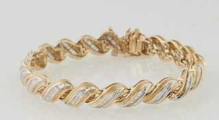 Vintage 18K Yellow Gold Flexible Link Bracelet, each of the 20 swirled links with a central conforming row of nine graduated baguette diamonds, with a