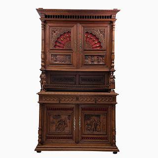 Buffet. Francia. Siglo XX. Estilo Bretón. En talla de madera de roble. A 2 cuerpos. Con 2 cajones y 4 puertas. 242 x 140 x 60 cm