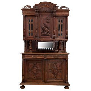 Buffet. Francia. Siglo XX. Estilo Enrique II. En talla de madera de roble. A 2 cuerpos. Con 2 cajones y 5 puertas. 243 x 140 x 53 cm
