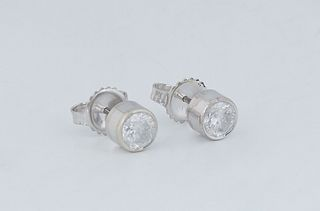 Pair of 14K White Gold Diamond Stud Earrings, each with a .5 ct. channel set round diamond, total diamond wt.- 1 ct., with appraisal.