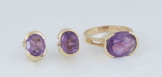 Vintage Three Piece Set of 14K Yellow Gold Jewelry, consisting of a ring with a horizontal mounted oval 3 ct. amethyst, Size 6, and a pair of clip ear