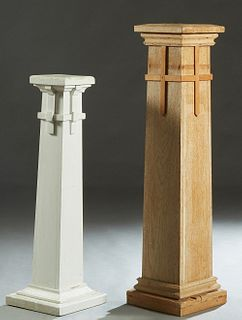 Two Cypress Pedestals, c. 1900, the square tops over square supports with applied cross decoration, on a stepped plinth base, the shorter painted whit