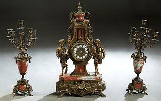 Three Piece Louis XV Style Gilt Brass and Rouge Marble Clock Set, late 20th c., the Franz Hermle time and strike lyre form clock with a marble urn sur